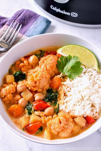 vegetable curry with lime in white bowl