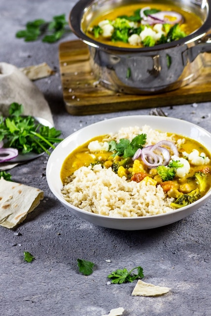 brocolli curry in a white bowl