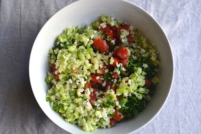 finely chopped veggies in a white bowl