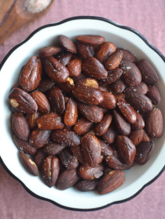 roasted almonds in white plate