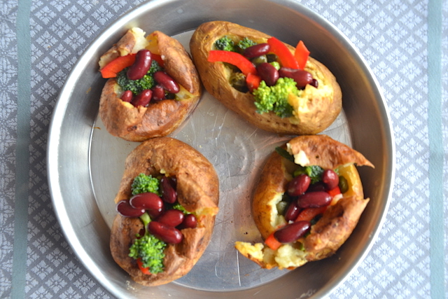 baked potatoes with veggies in a pan
