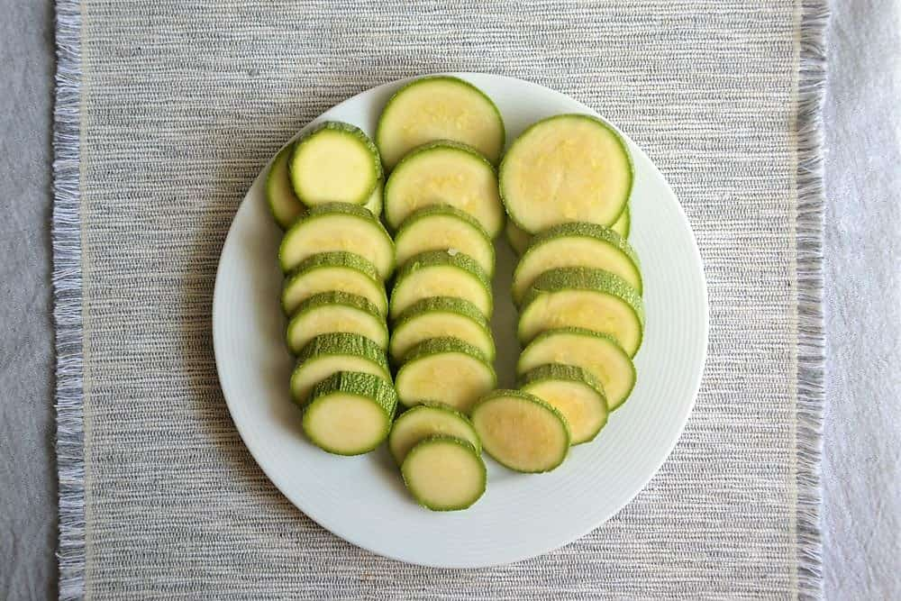 slices of squash in a white plate