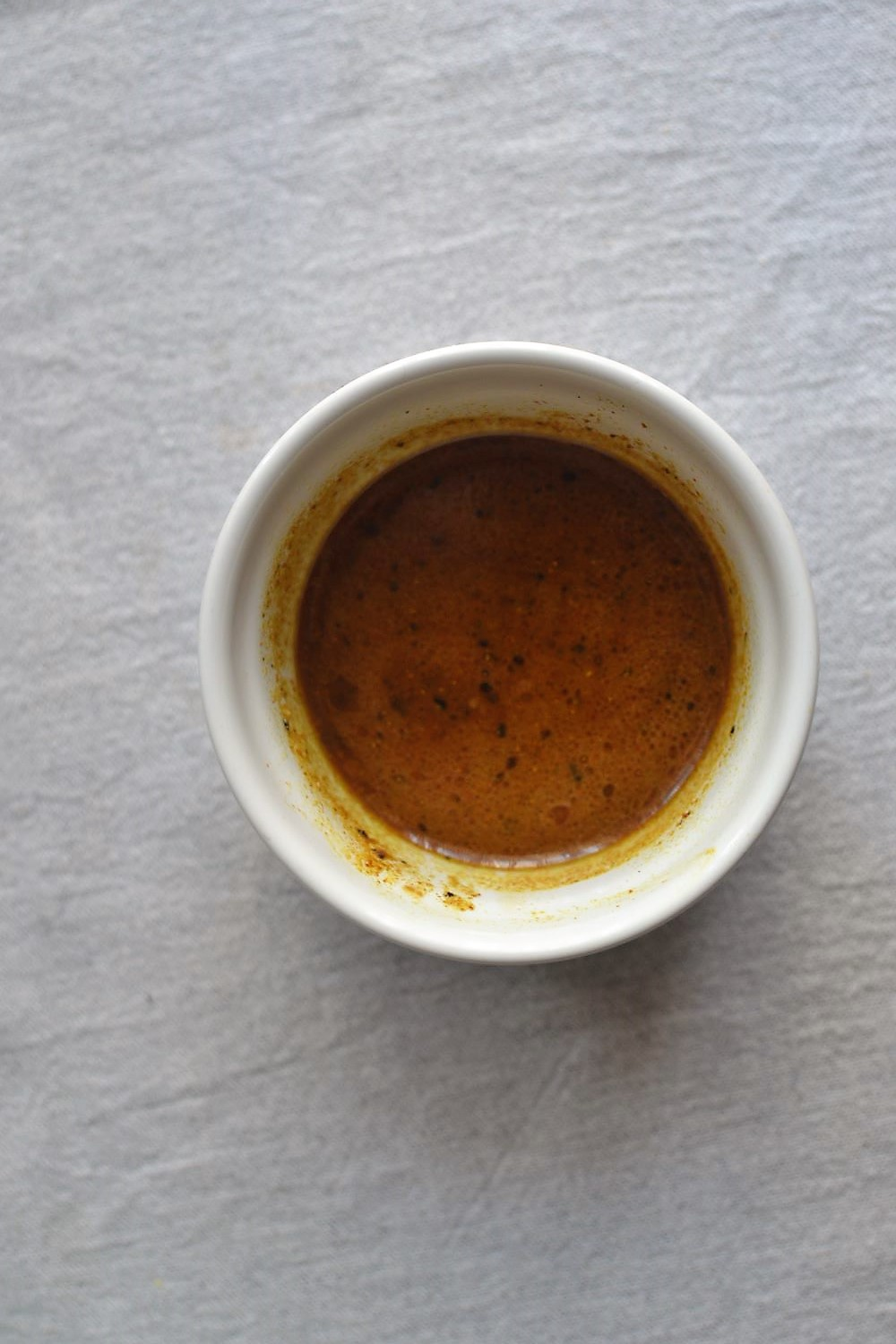 vinegar sauce in a white bowl