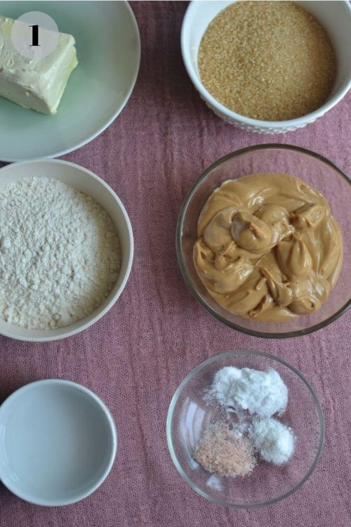 peanut butter, almond flour, spices, butter and sugar in a wooden board