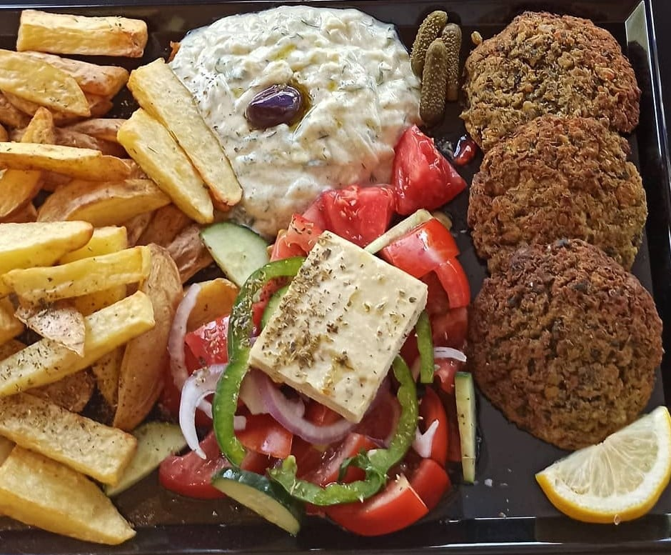 falafel with fries, greek salad and vegan cheese